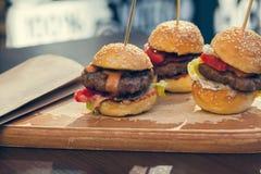 Three Mini Burgers Sliders Royalty Free Stock Images