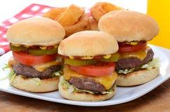 Three Mini Cheeseburger Sliders with Onion Rings Royalty Free Stock Photos