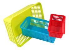 Three  mini household colored storage plastic basket Royalty Free Stock Photo