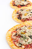 Three Mini Pizzas in a Row Stock Photography