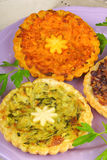 Three mini vegetarian quiches Royalty Free Stock Photos
