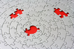 Three missing pieces in a grey jigsaw. Focus is on the center hole - adobe RGB Royalty Free Stock Images