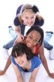 Three mixed race girl friends having fun together Royalty Free Stock Image