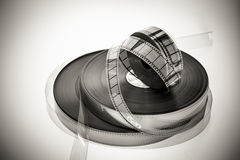 Three 35mm movie reels in black and white. Three 35mm movie reels in vintage black and white, rolls on white background stock photos