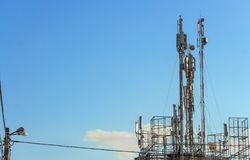 Three mobile phone communication tower transmission signal Royalty Free Stock Image