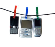 Three mobiles on clothes line royalty free stock images