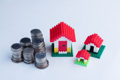 Three model house with coin towers Stock Photos