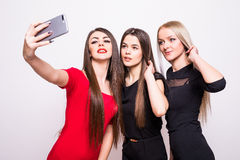 Three models in dresses make selfie. Royalty Free Stock Photos