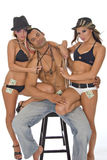Three models posing. Two beautiful caucasian women models and one handsome muscular male posing in gambling costumes on white background Stock Images
