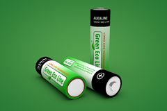 Three Modern Eco Batteries on Green Royalty Free Stock Images