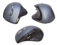 Three Modern Ergonomic Mouses isolated. On the white background Royalty Free Stock Photos