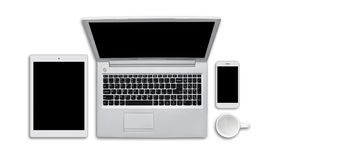 Three modern gadgets: tablet, computer and cell phone laying on white background. Top view of electronic devices and white empty m. Ug on white surface with copy royalty free stock photo