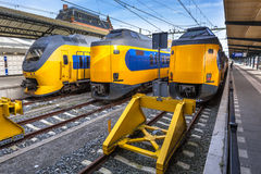 Three modern trains waiting at station Royalty Free Stock Photo