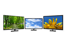 Three modern TV set with different images Stock Photos