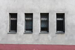Three modern window frames on a blank grungy brown concrete wall under royalty free stock image
