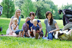 Three Moms and four children at park Royalty Free Stock Photography
