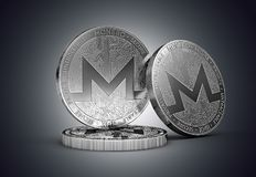Three Monero cryptocurrency physical concept coin on gently lit dark background. 3D rendering stock illustration