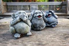 Three monkey statues royalty free stock photo