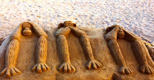 Three monkeys concept. Three monkeys no see no talk no hear concept made in sand Stock Images