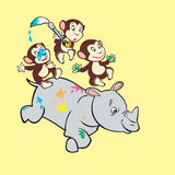 Three monkeys and rhino Stock Images