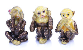 Three monkeys. Souvenir figurines of the three monkeys, symbolizing the Buddhist idea of non-doing of evil, detachment from false (see nothing, hear nothing, say Stock Image