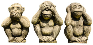 Three monkeys statues. On the white background stock images