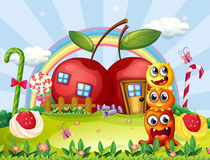 Three monsters in front of the apple house Royalty Free Illustration