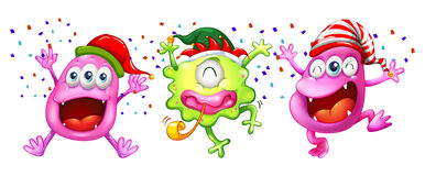 Three monsters wearing party hats Royalty Free Stock Photos