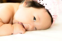 Three month old asian baby is prone Royalty Free Stock Photo