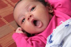 A three month old healthy Indian shouting happy baby royalty free stock photography