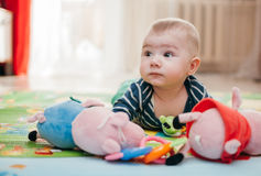 Three-months kid. Baby boy 3 months old looking with surprise Stock Image