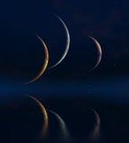 Three moons. And Quiet Sea Royalty Free Stock Photos