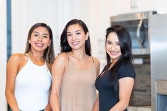 Three Moms In The Kitchen royalty free stock image