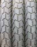 Three motocycle tyre face Stock Image