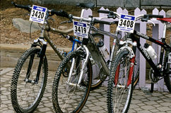 Three mountain bikes Stock Images
