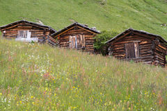 Three mountain huts in South Tyrol, Italy Royalty Free Stock Photo