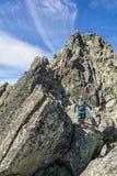 Three mountaineers on the ridge. royalty free stock image