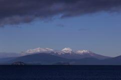 Three mountains of National Park. Mount Ruapehu, Mount Ngauruhoe, and Mount Tongariro across lake Taupo. North island New Zealand Stock Images