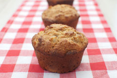 Three muffins Stock Images