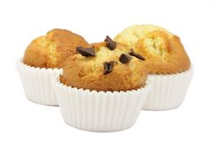 Three muffins. Ecological. That of the center with pips of chocolate stock photos
