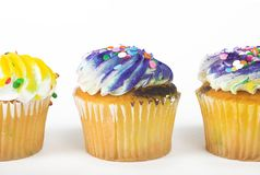 Three muffins. Three frosted cupcakes royalty free stock image