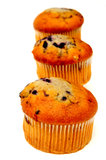 Three Muffins. Blueberry muffins lined up in a row on a light colored background Royalty Free Stock Photography