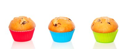 Three muffins with chocolate Stock Photos