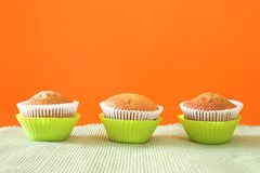 Three muffins in green cups Royalty Free Stock Photo