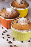 Three muffins with icing sugar. And chocolate balls Royalty Free Stock Photography