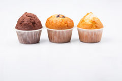 Three muffins isolated. On white background Stock Image