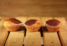 Three muffins. In paper cups stock images