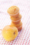 Three muffins and pear Stock Image