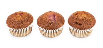 Three muffins in row isolated on white Stock Photo
