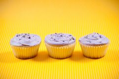 Three muffins with vanilla and chocolate filling Stock Photo